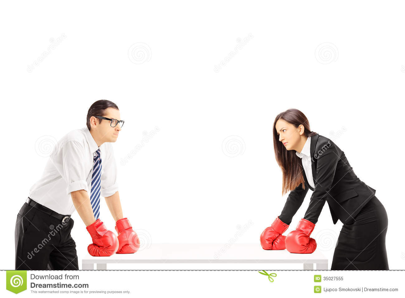 Two angry businesspeople with boxing gloves having an argument