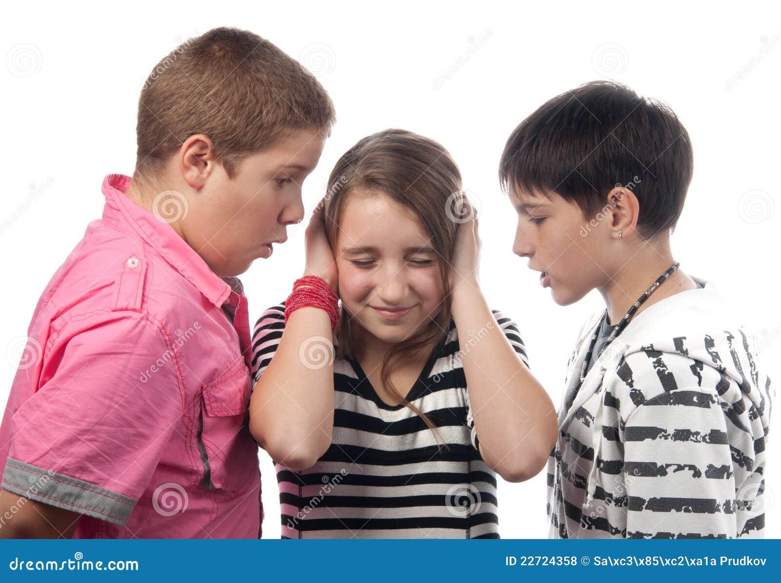 Two angry teenage boys and the girl