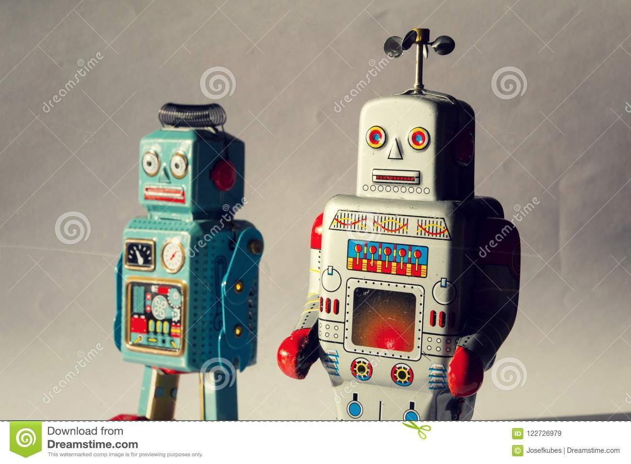 Two angry vintage tin toy robots, artificial intelligence, robotic drone delivery, machine learning concept