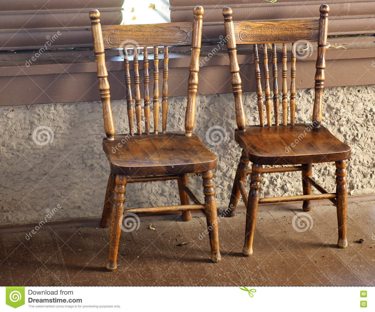 Two Antique Press Back Chairs - Two Antique Press Back Chairs Stock Image - Image Of Wooden, Against