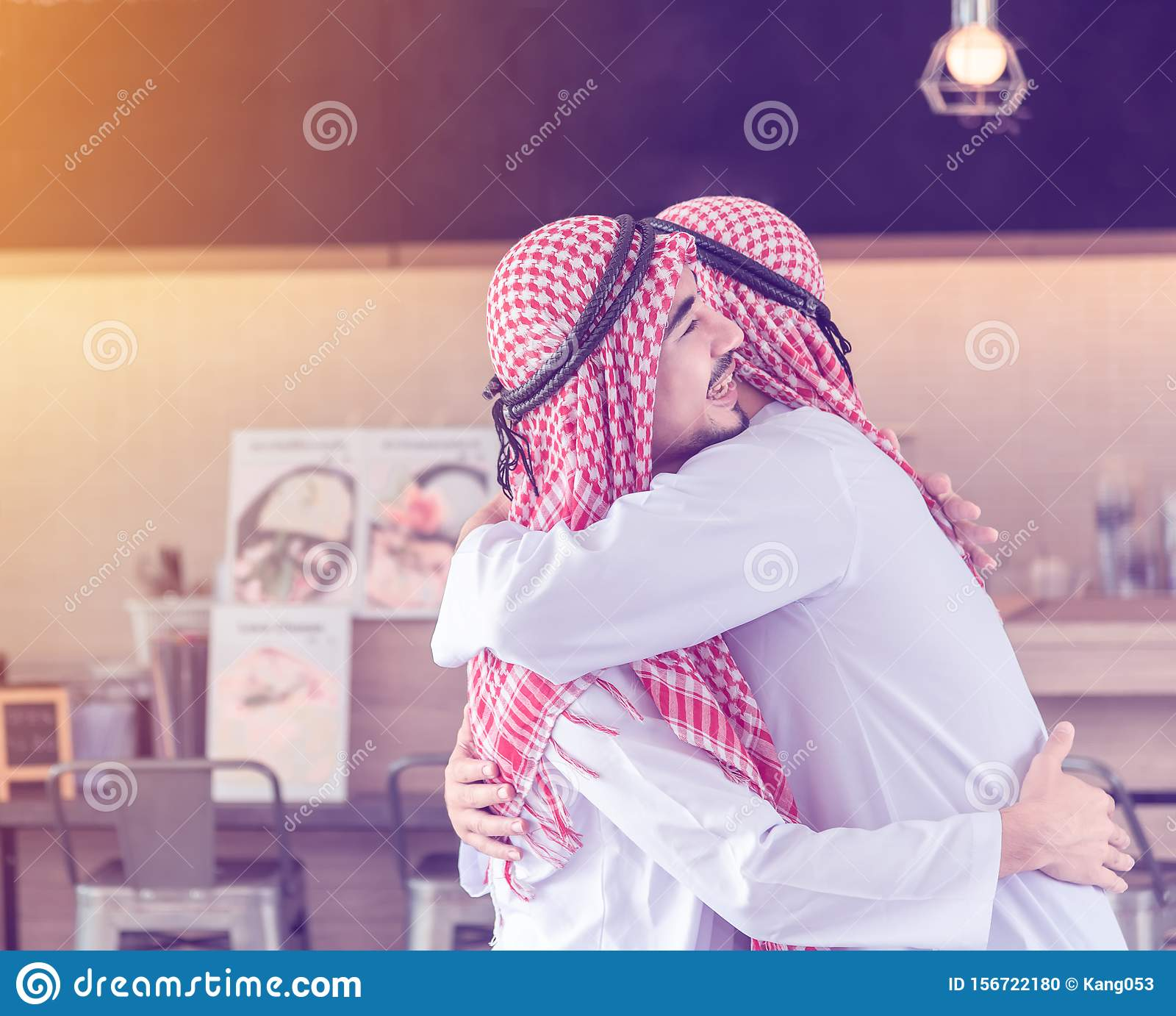 Two Arabian Men Who Are Friends Together Are Hugging And