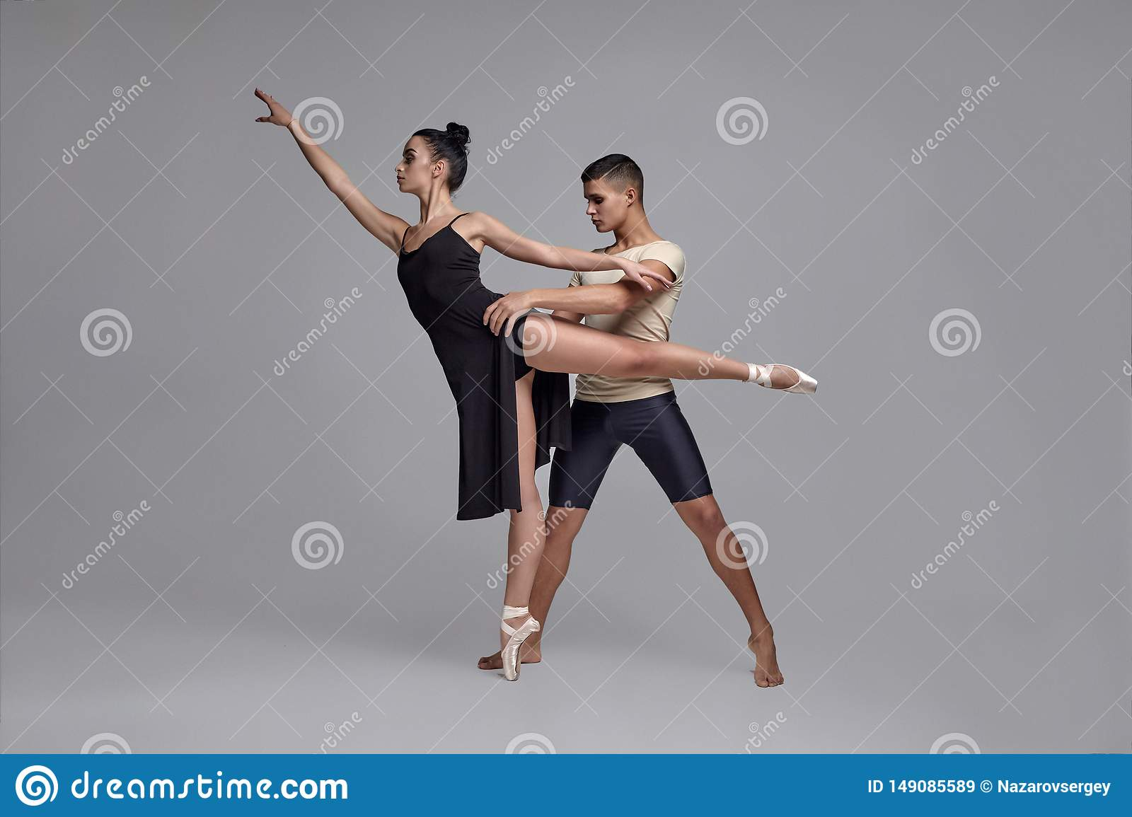 Two Athletic Modern Ballet Dancers Are Posing Against A Gray Studio  Background. Stock Image - Image of gorgeous, ballet: 149085589