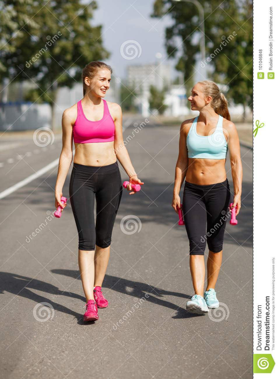 Sports Girls With Bottles Of Water Walking On A Park Background Fitness Concept Copy Space Stock Photo Image Of Healthy Outdoor 101046848