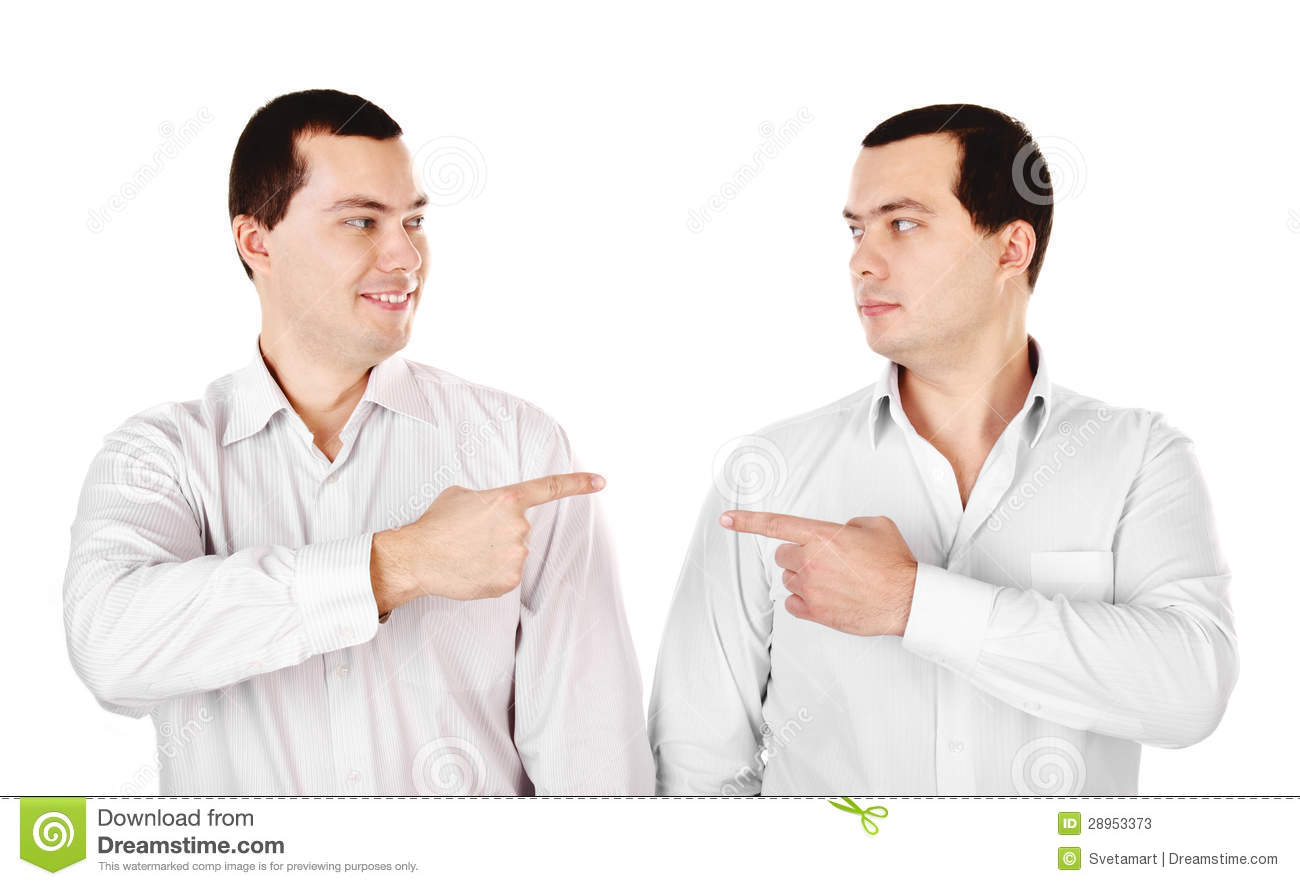 Two Attractive Smiling Young Men Twins Showing At Each