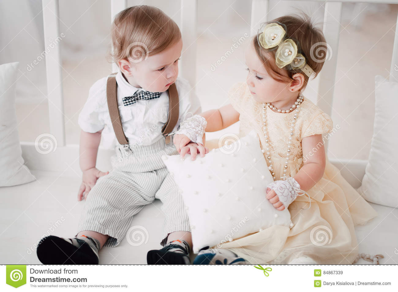 two babies wedding boy and girl dressed as bride and
