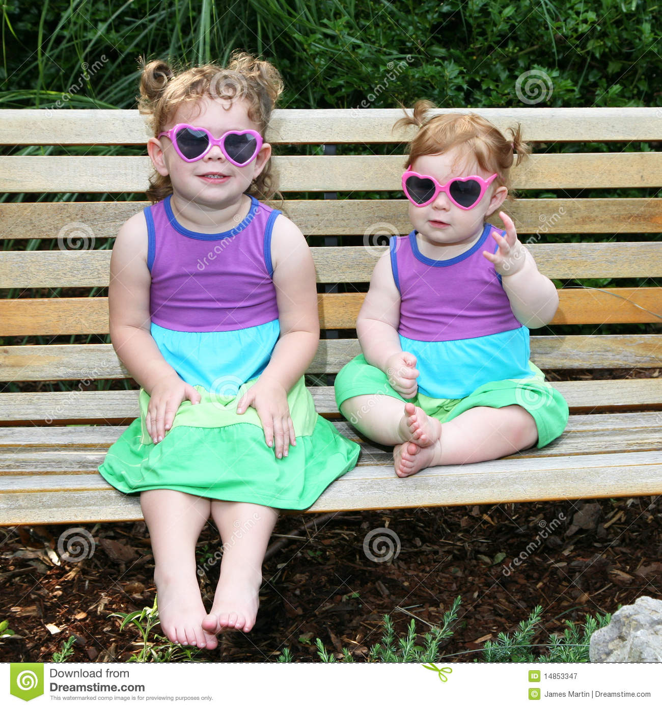 Two baby girls in sunglasses and sun dresses-3