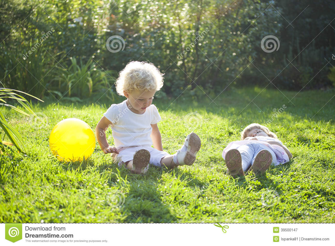 Two baby on a grass