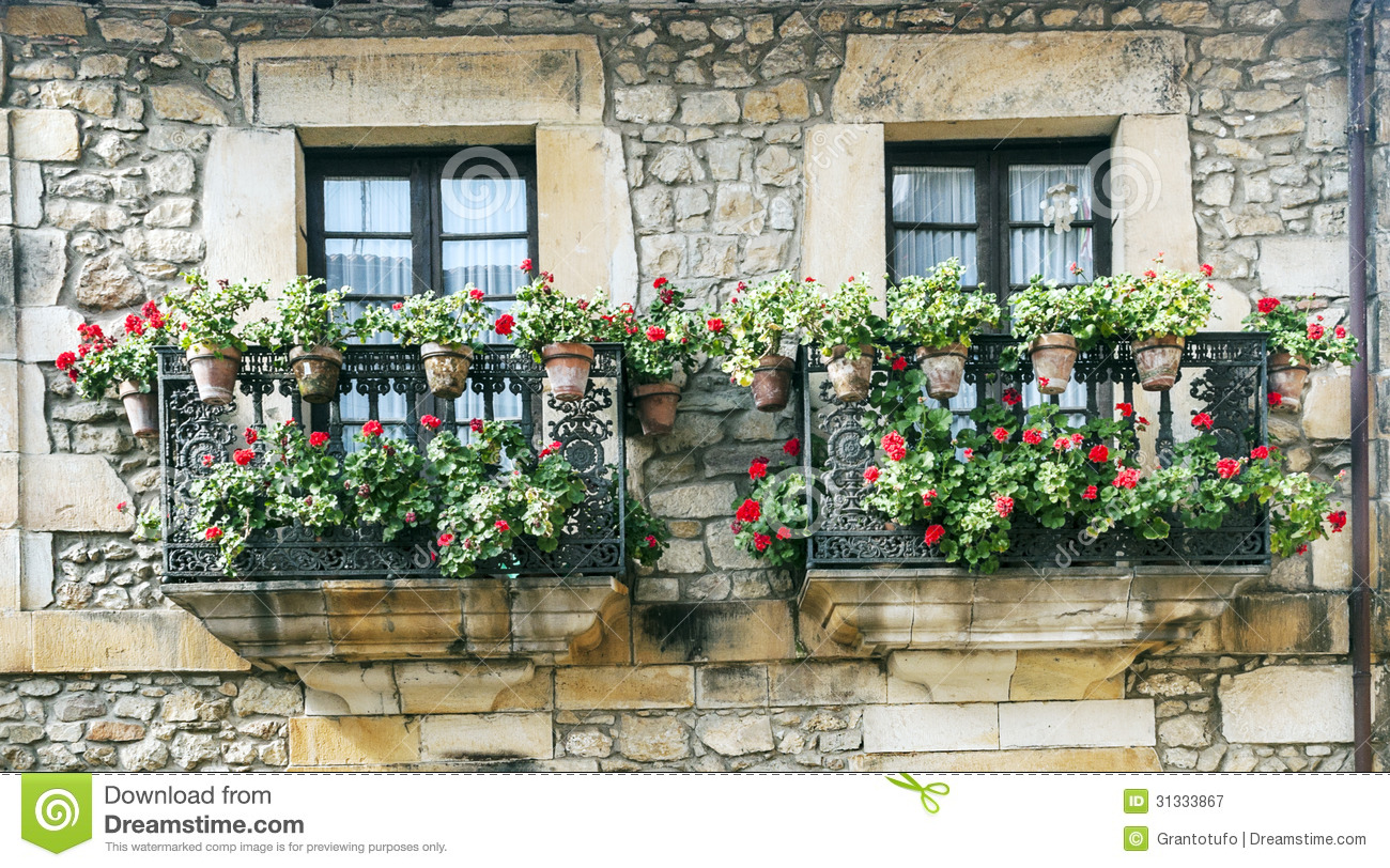 royalty free stock photo download two balconies with potted plants