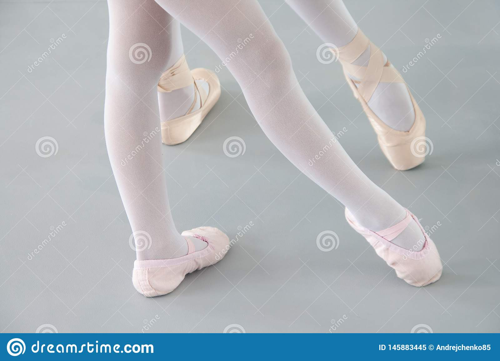 Two ballerinas in ballet shoes