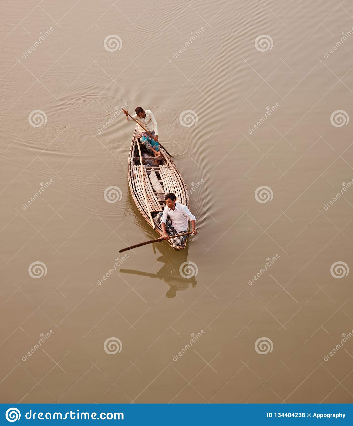 Two men riding on a traditional boat