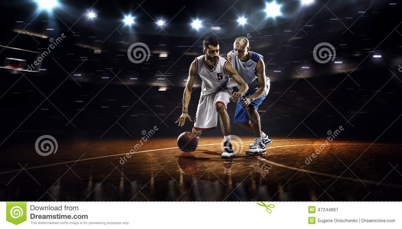 Two basketball players in action