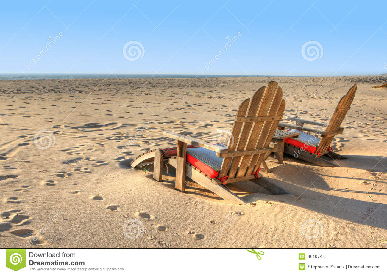two beach chairs sitting in the sand stock photo image of island