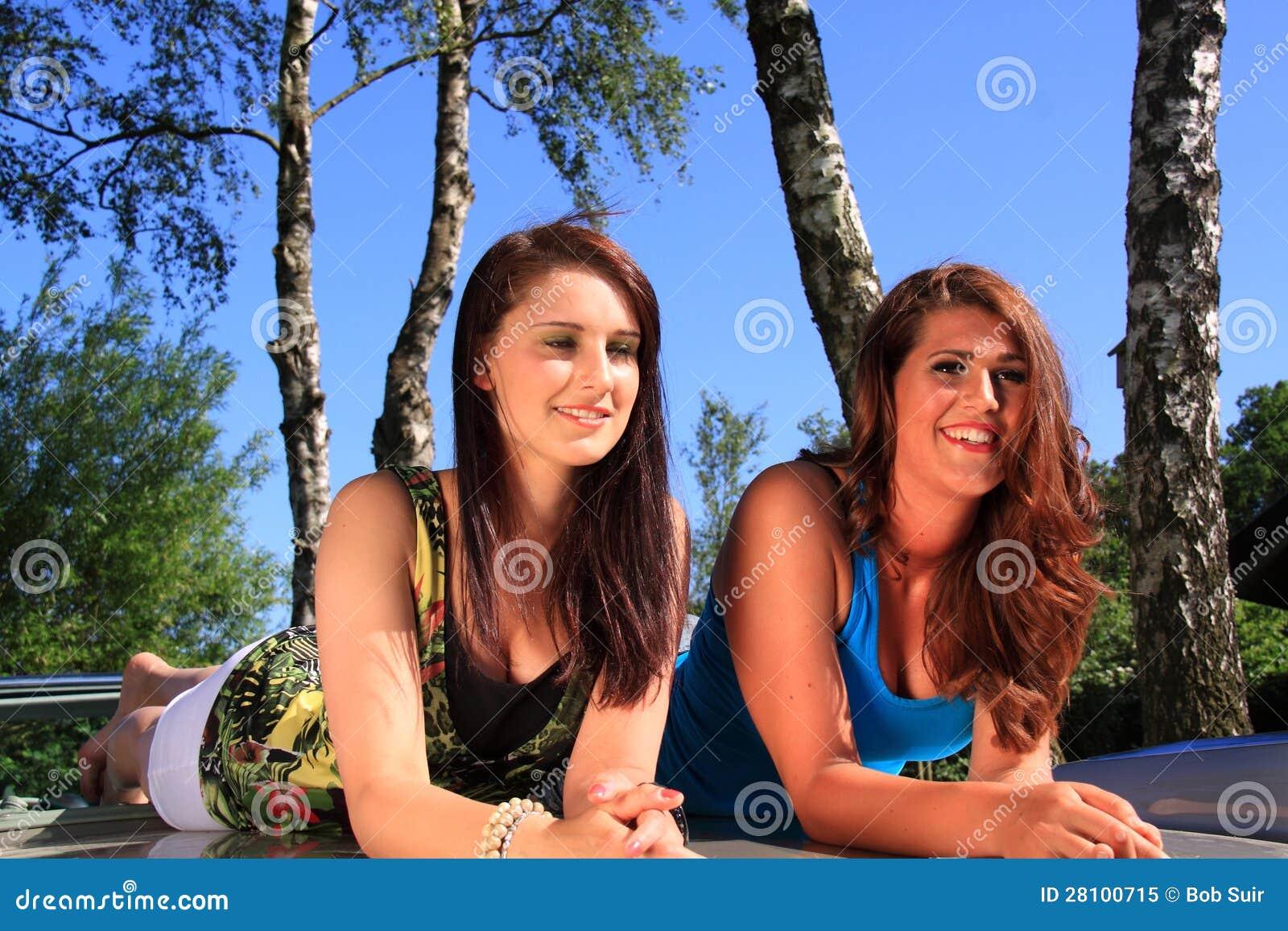 Two beautiful brunette girls relaxing