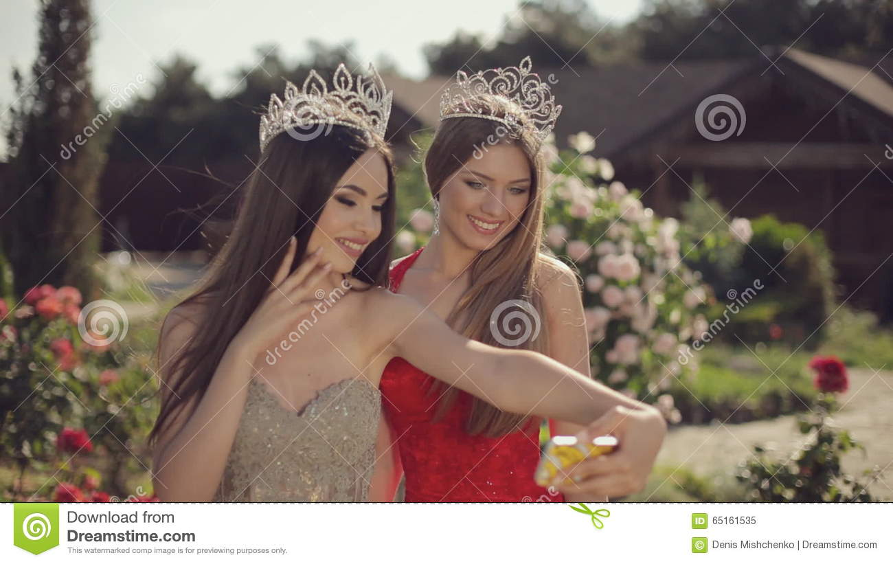 Two Beautiful Girls In Evening Gowns And Crowns Stock Video - Video ...
