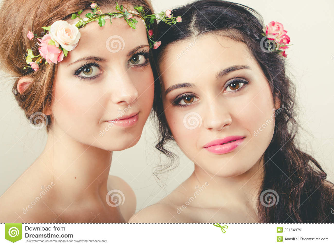Two Beautiful Girls With Flowers In Head Stock Photo ...