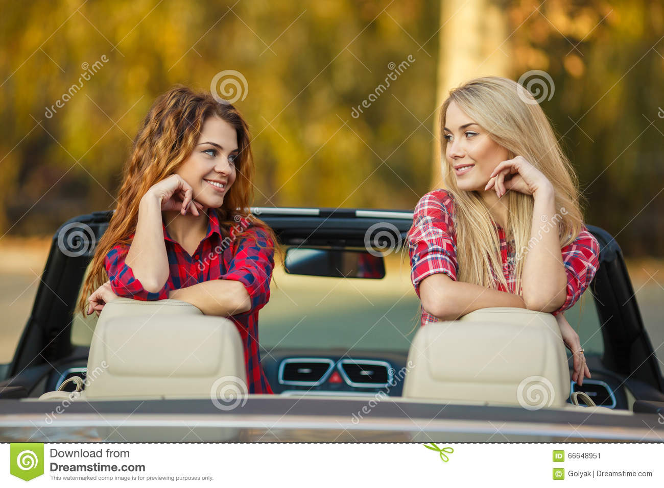 Two Beautiful Girls Are Traveling In Convertible Stock Image - Image ... 254b589757d88