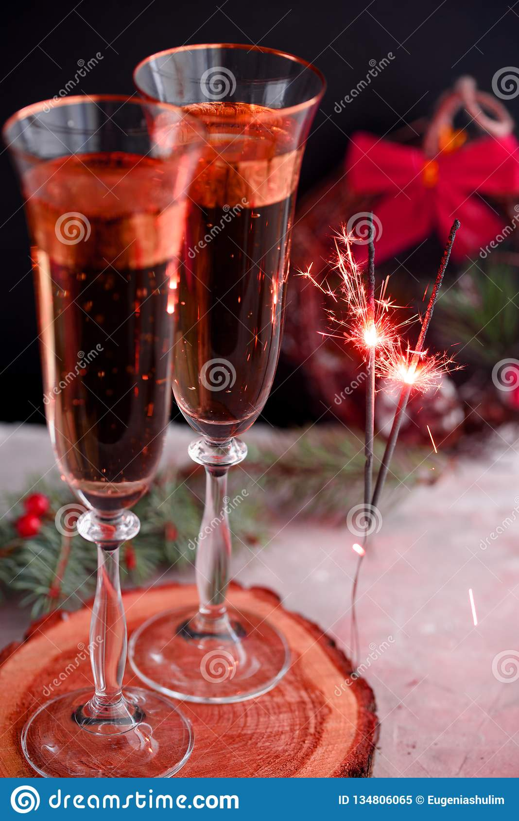 Two glass champagne glasses.Two beautiful glass champagne glasses on New Year`s Eve.painted in the fashionable color of 2019