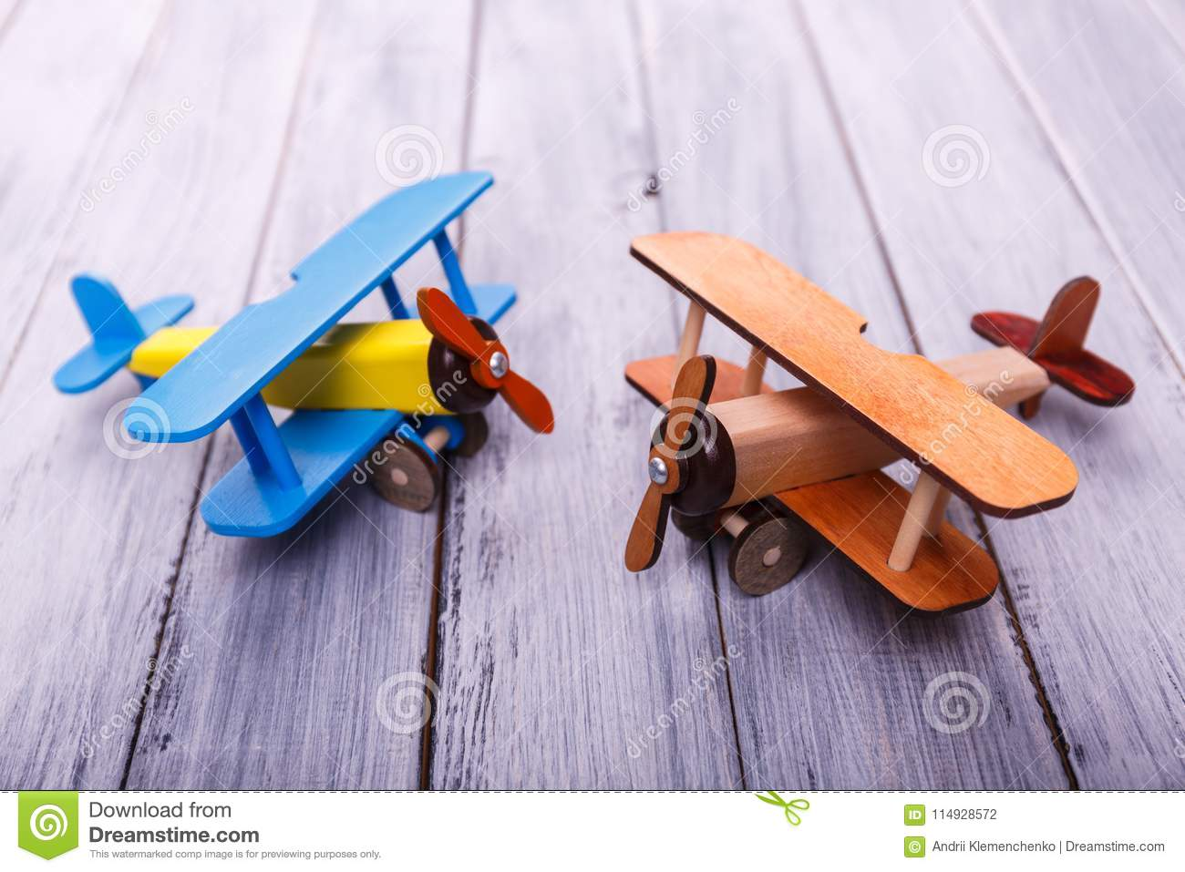 Childrens Toy Airplanes On The Wooden Background Game Concept