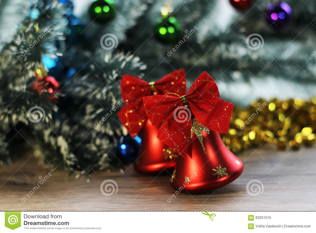 Download Two Beautiful Red Shiny Bells Closeup On The Background Of Christmas Tree And Tinsel