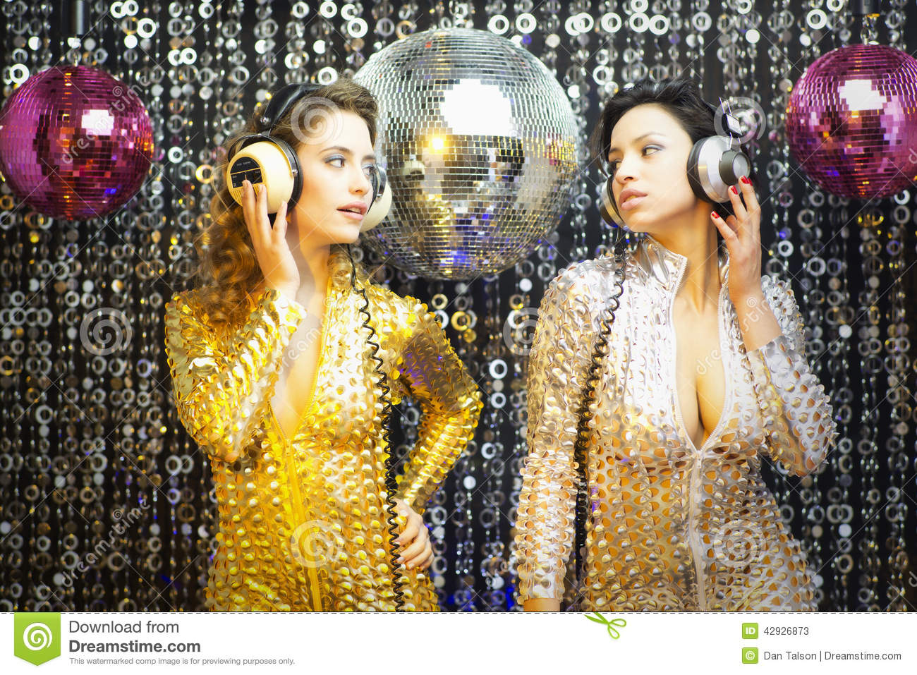 Two Beautiful Disco Women In Gold And Silver Catsuits