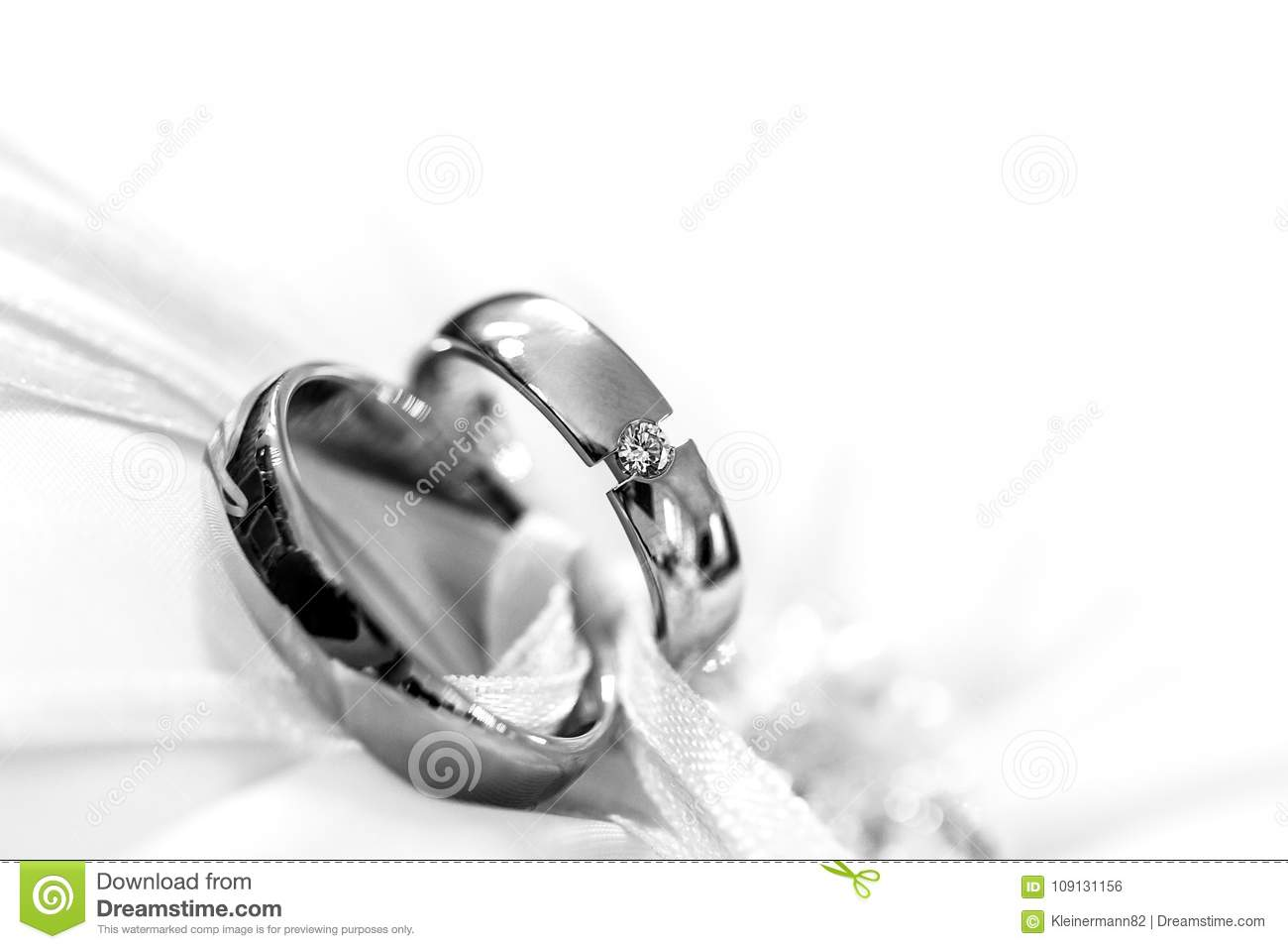 Beautiful Wedding Rings In Front Of Light Background On A Cloth