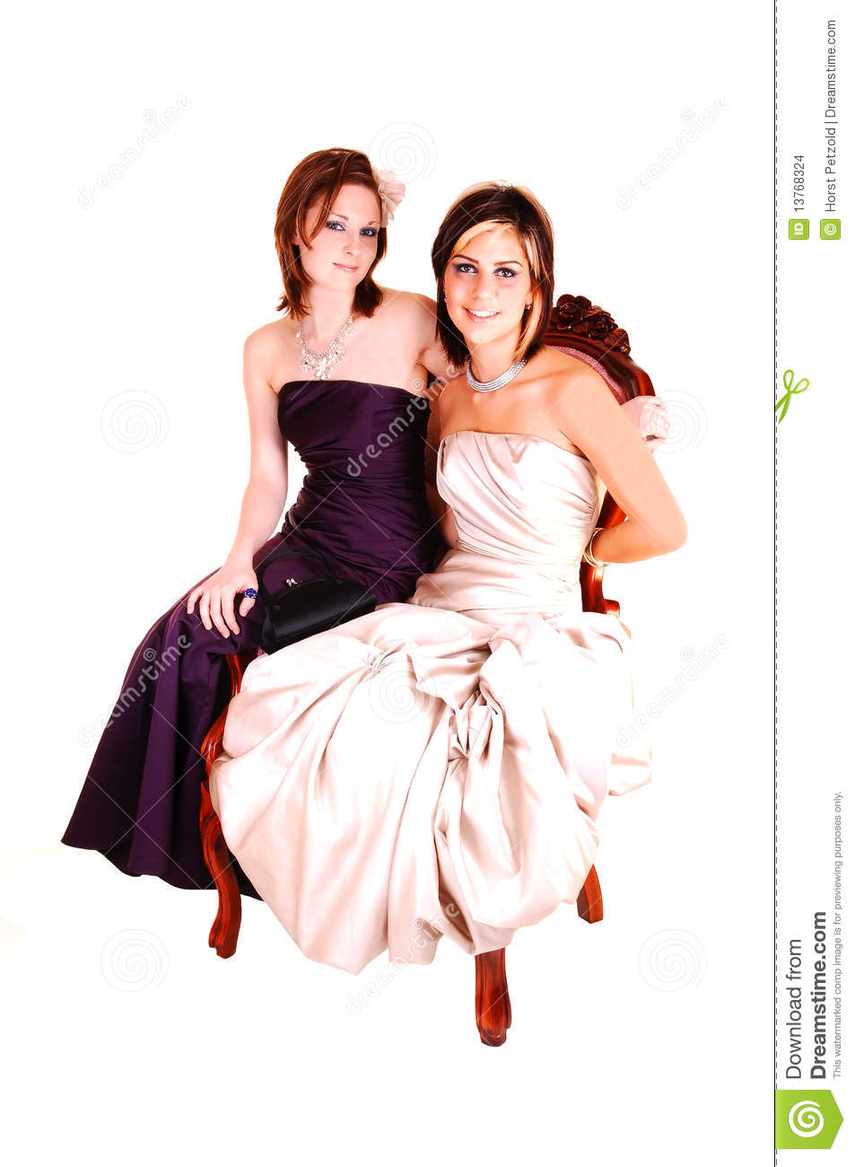 Two beautiful woman sitting in a armchair stock images for Sitting in armchair
