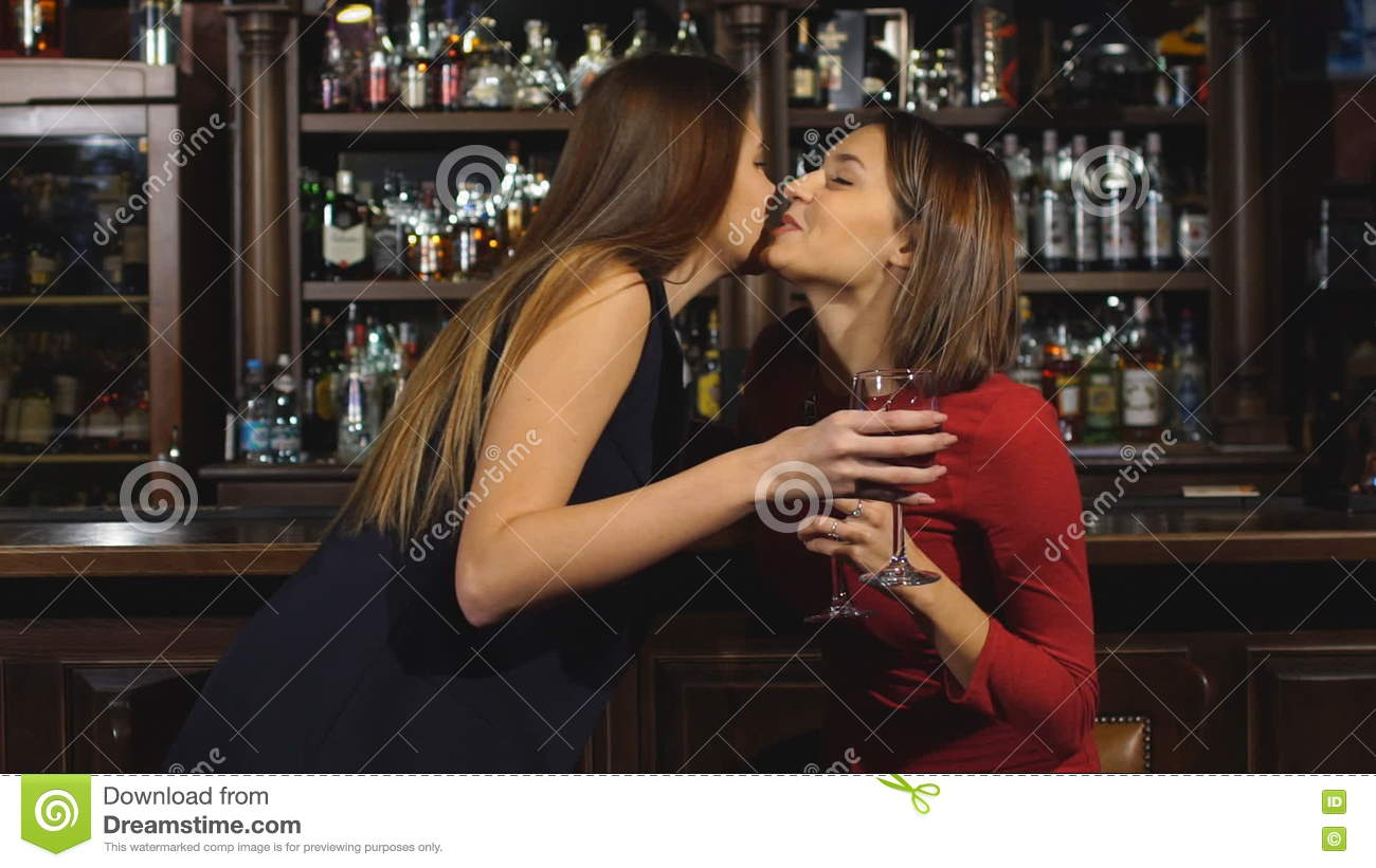 how to talk to a woman at a bar