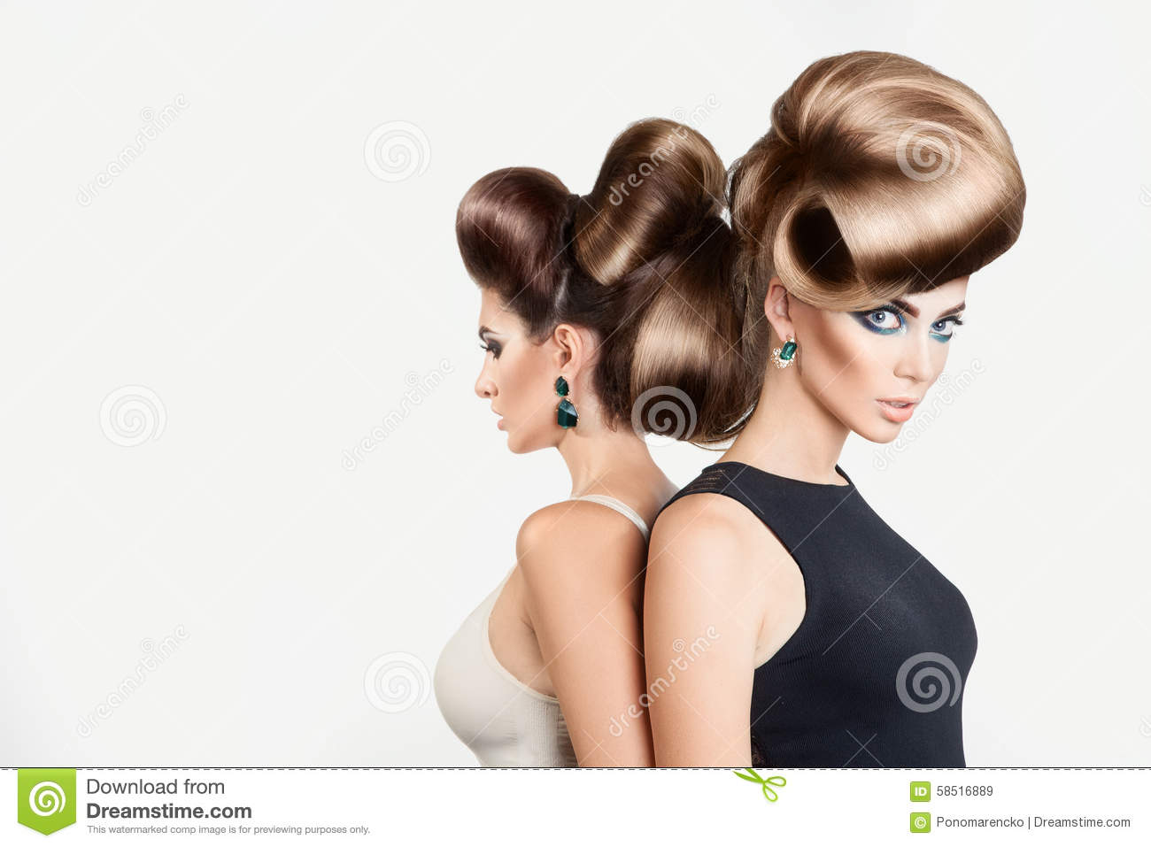 Two beautiful women in studio. Both with creative hairstyle and