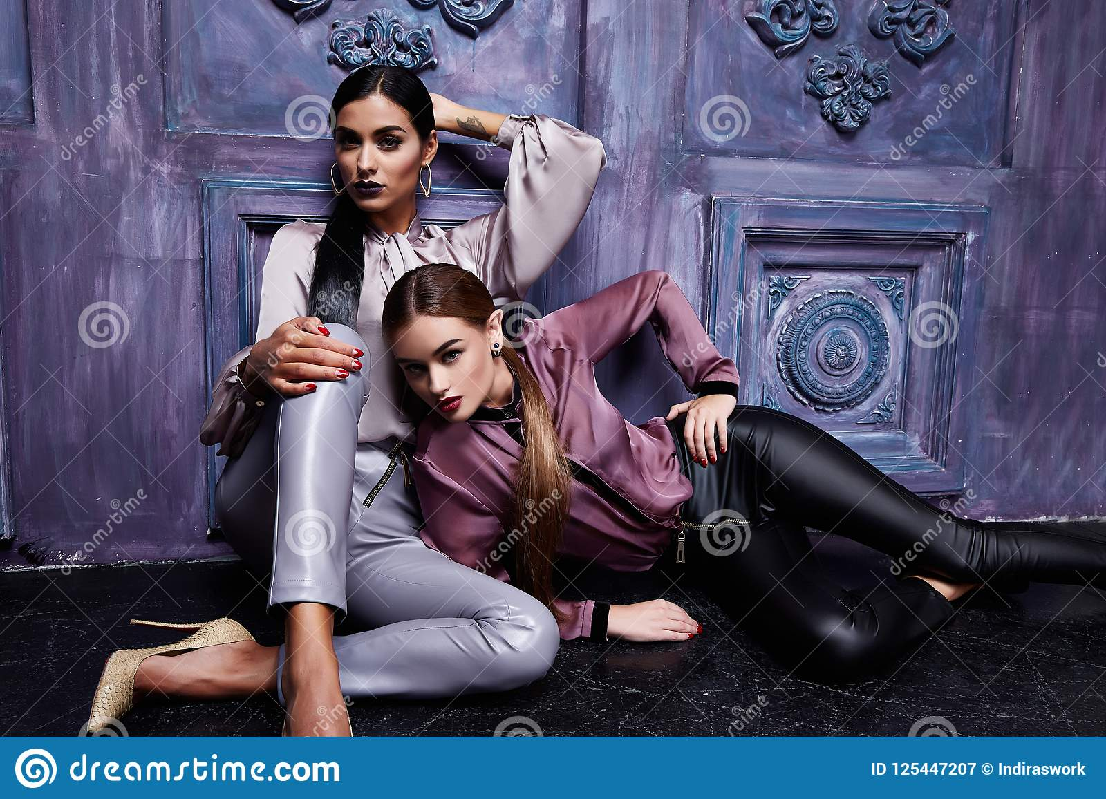 Two beautiful young business woman hair evening makeup wear