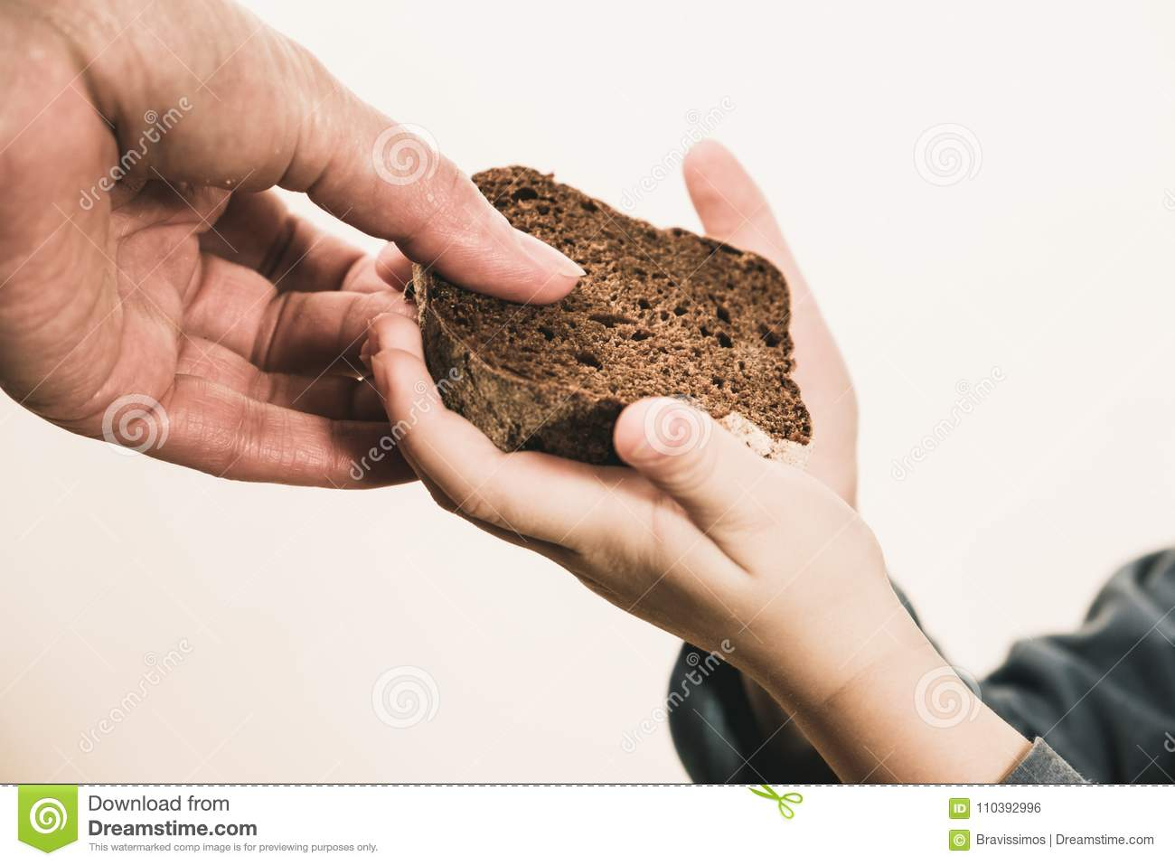 Two beggar hands palms with cheap bread. Poor children and people donations Volunteers Concept.