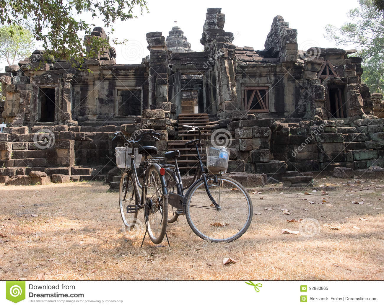 Two bikes on the background of the ruins at Angor Wat
