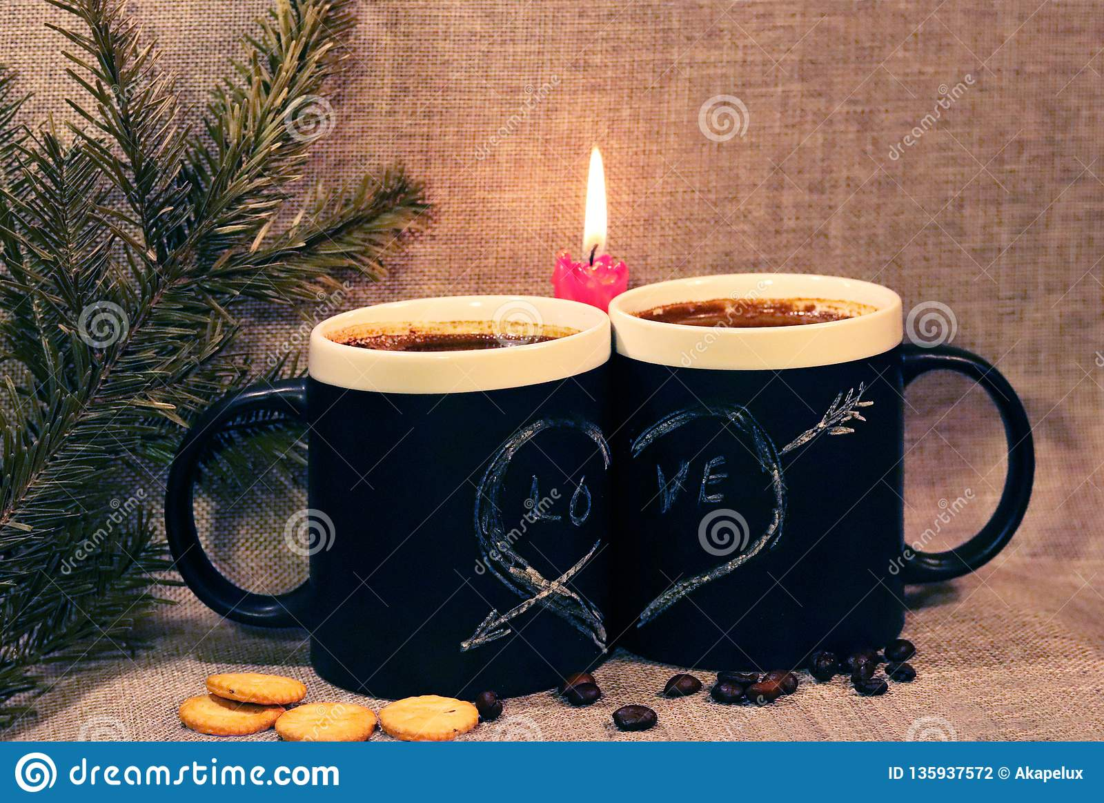 Two black circles with a symbol of love with a red candle and a branch of spruce. Heart pierced by an arrow drawn in white chalk
