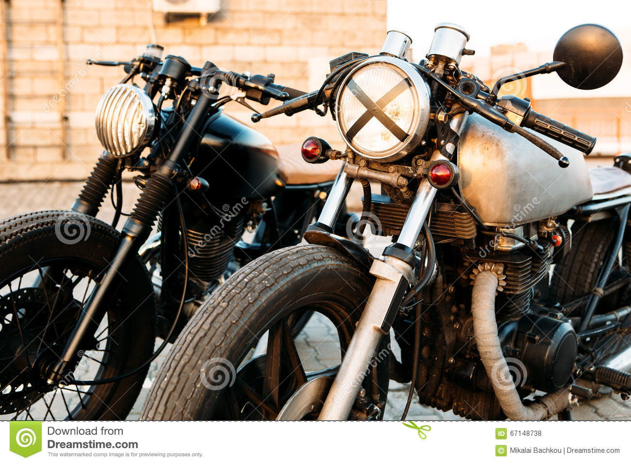 two black and silver vintage custom motorcycles cafe racers stock