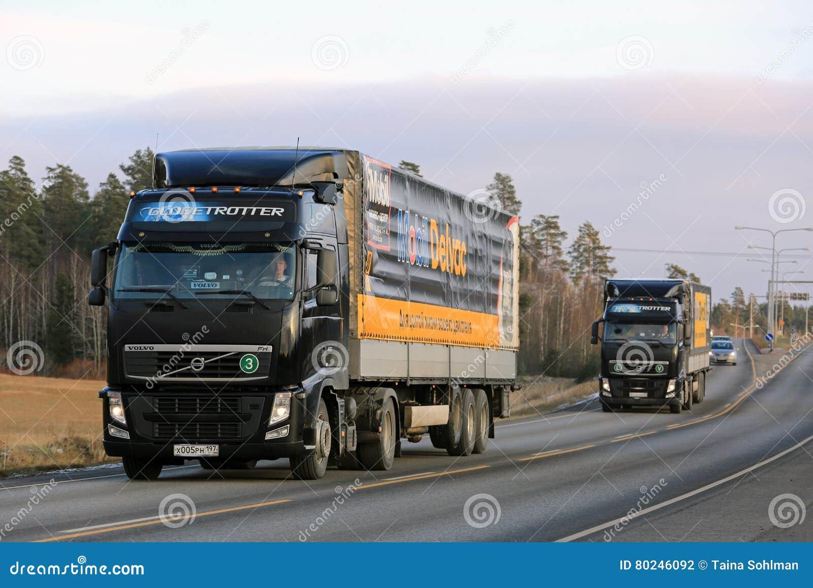 Semi Truck Oil : Two black volvo trucks haul mobil delvac oils editorial