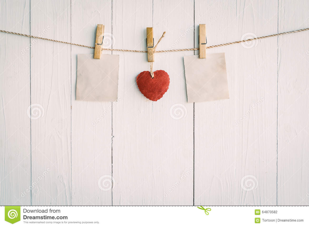 Two blank old paper and red heart hanging. On white wooden