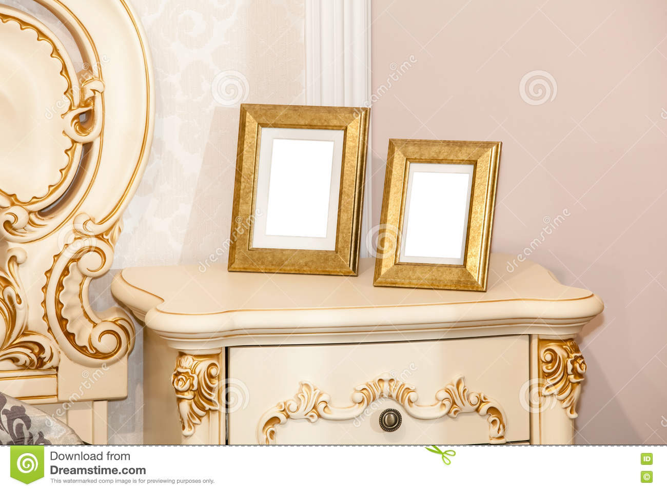 Two blank photo frame on the chest of drawers