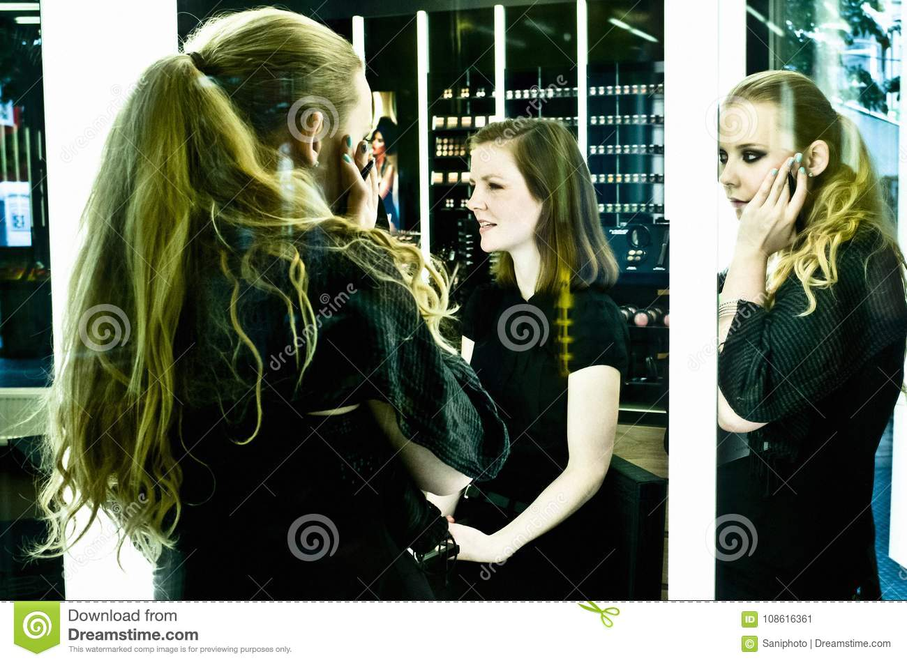 Two blonde young women in a beauty salon