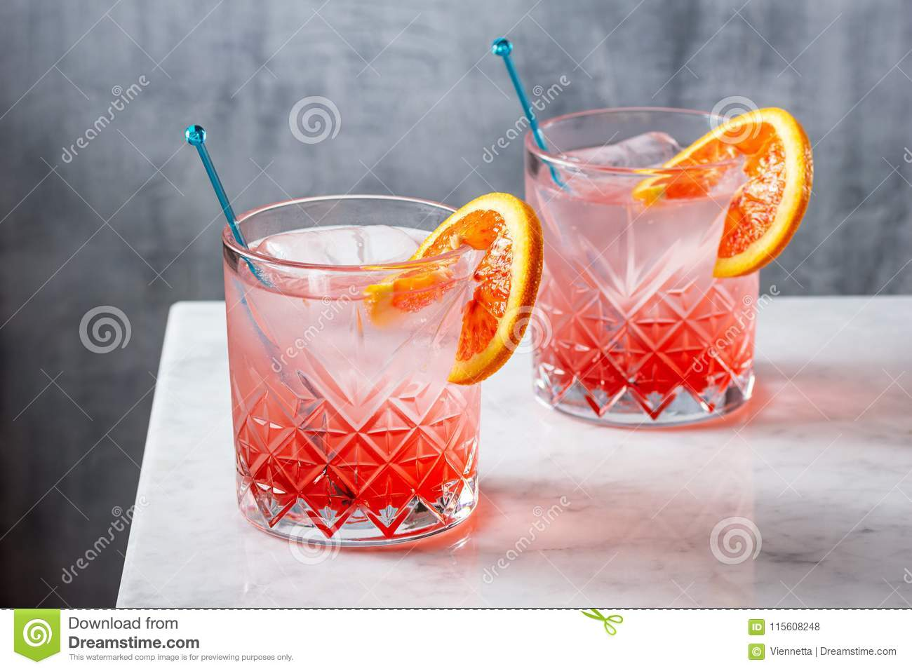 Two Blood Orange Gin and Tonic Cocktails on Counter