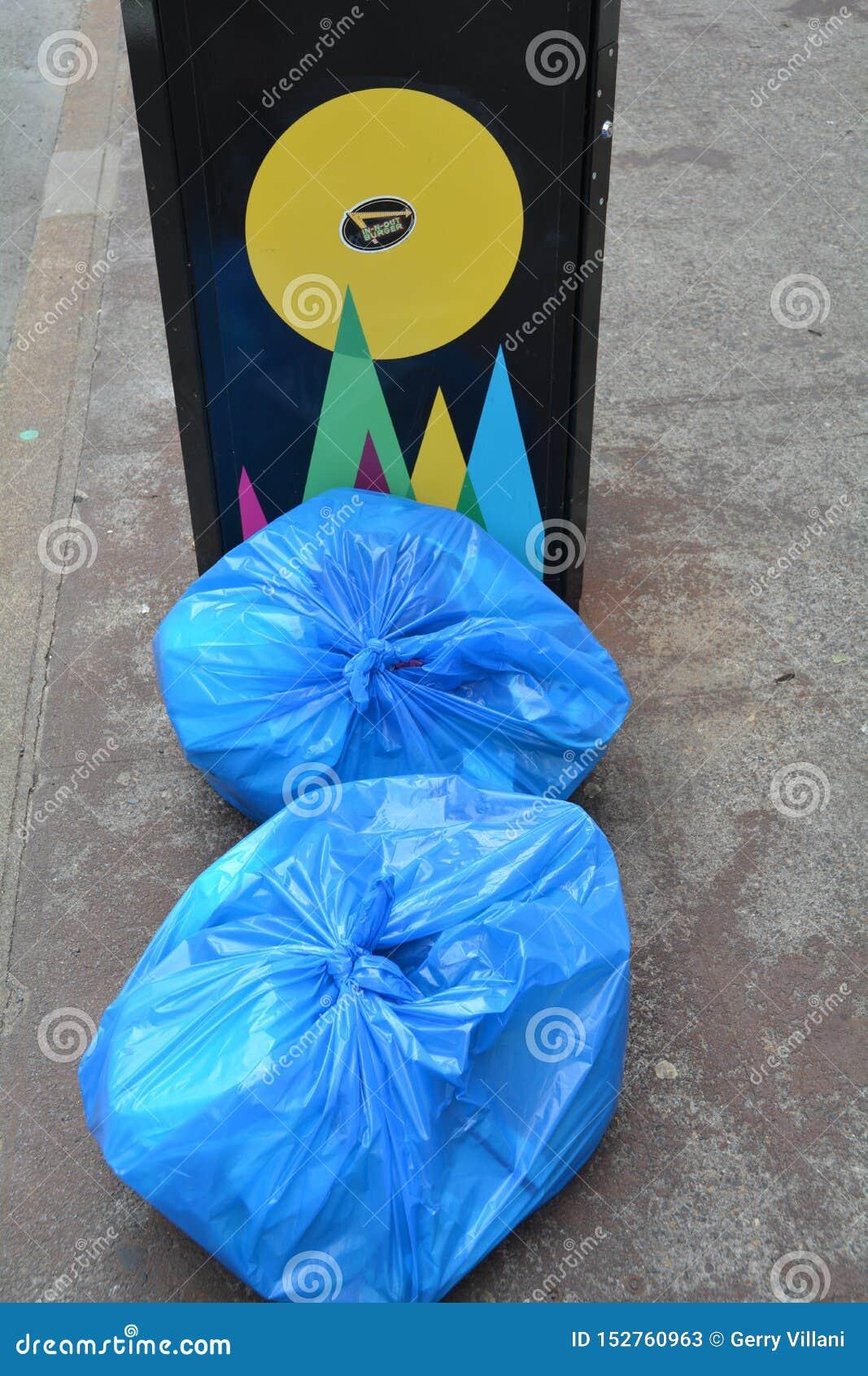 Two blue garbage bags in Portland, Oregon