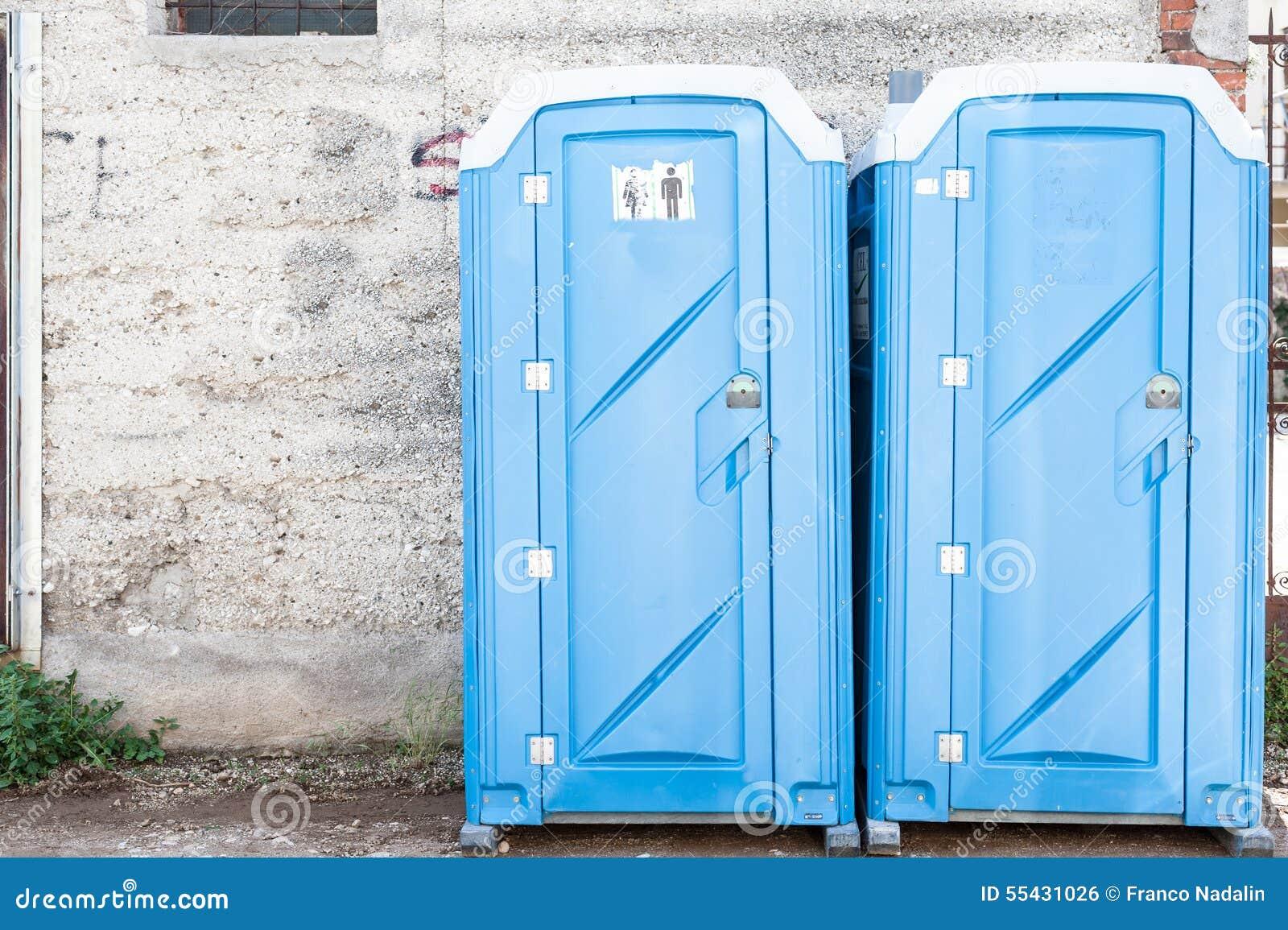 Construction Site Portable Toilets : Two blue portable toilet stock photo image