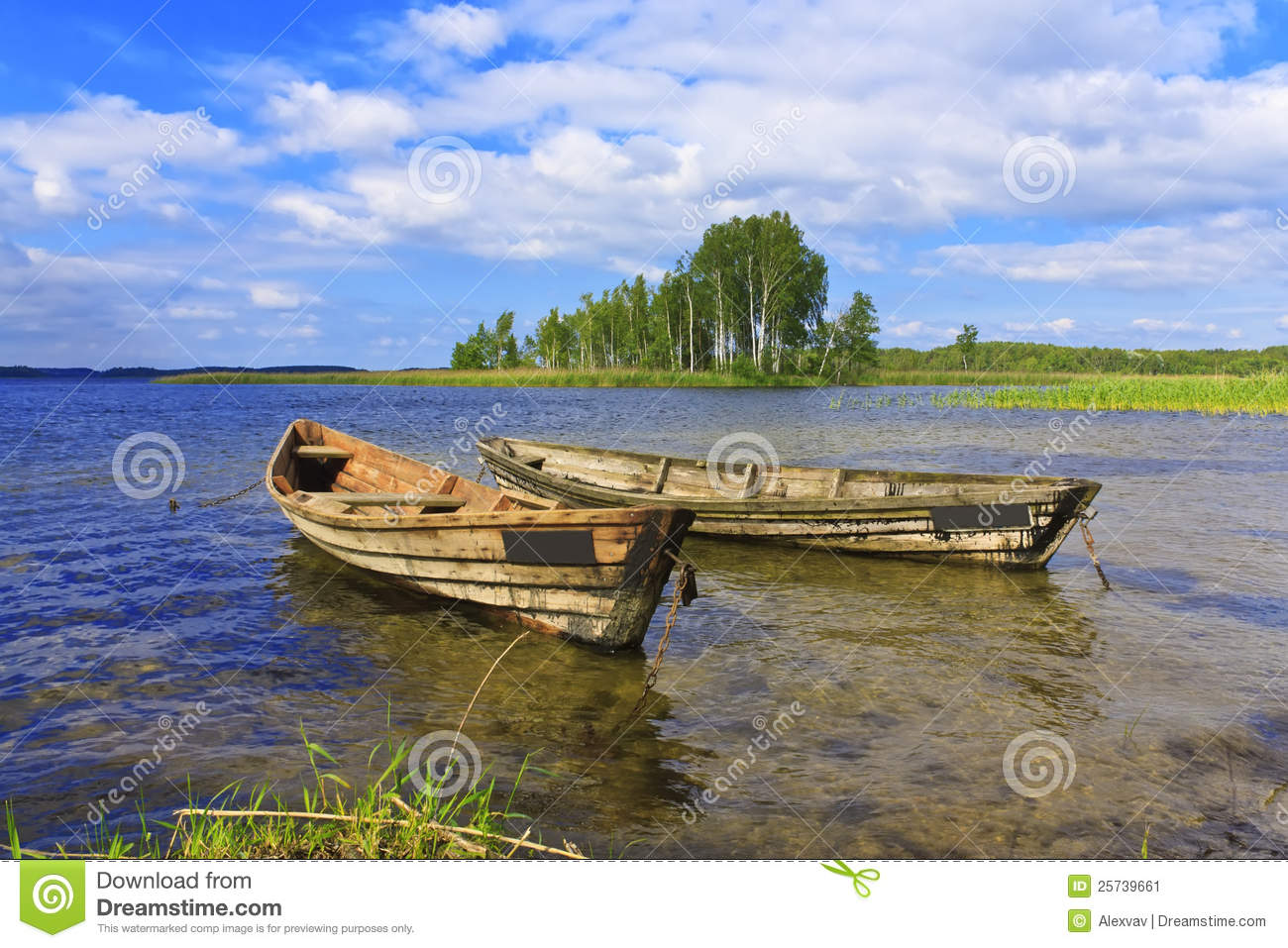 Two boats on the lake on blue sky background