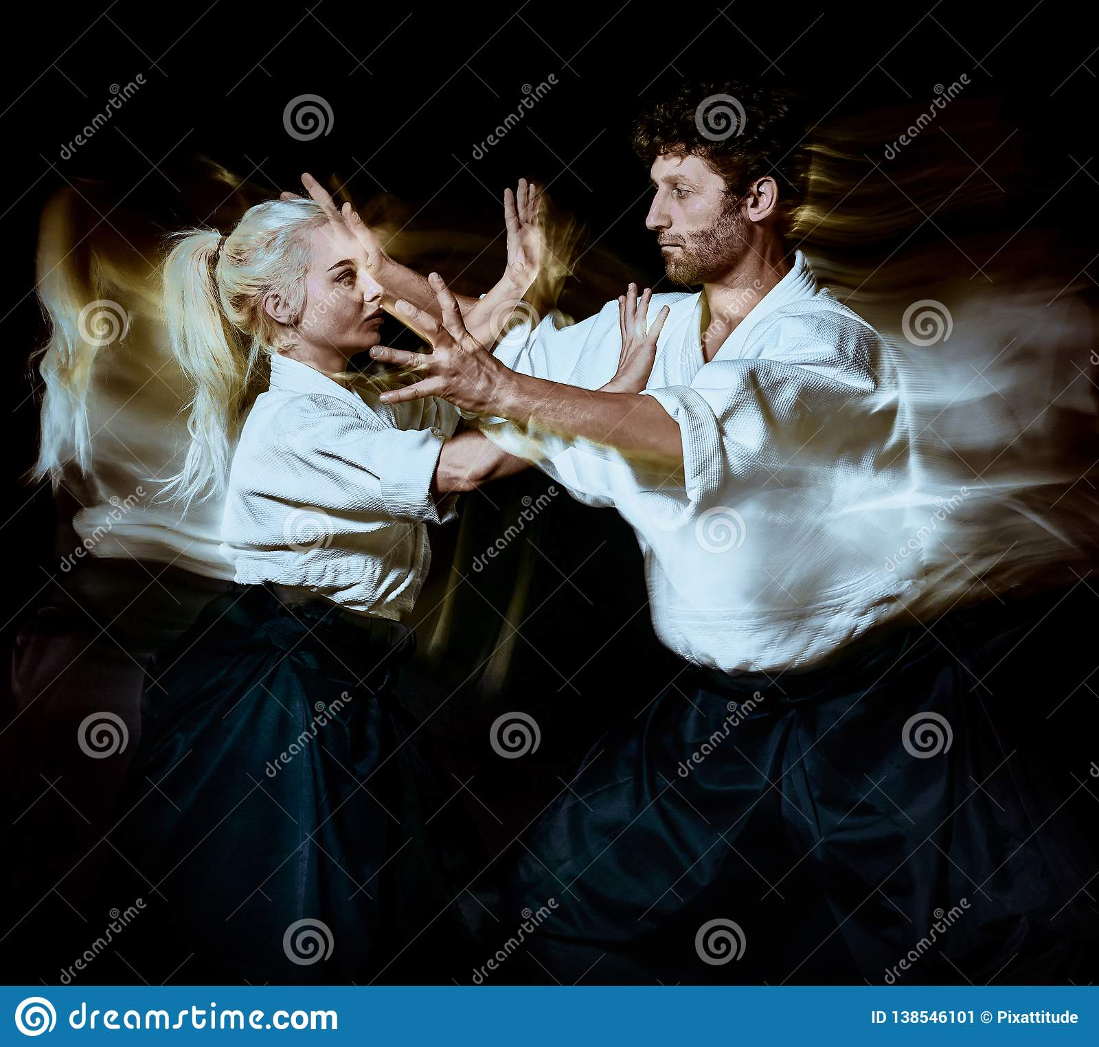 Aikido bodokas man and woman isolated black background