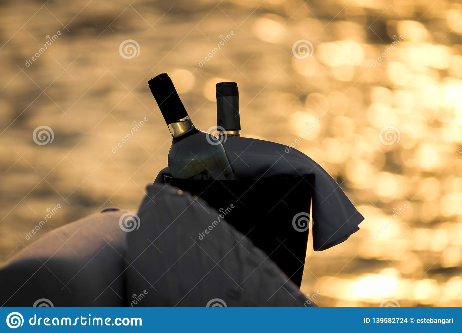 Two bottles of red and white wine on summer