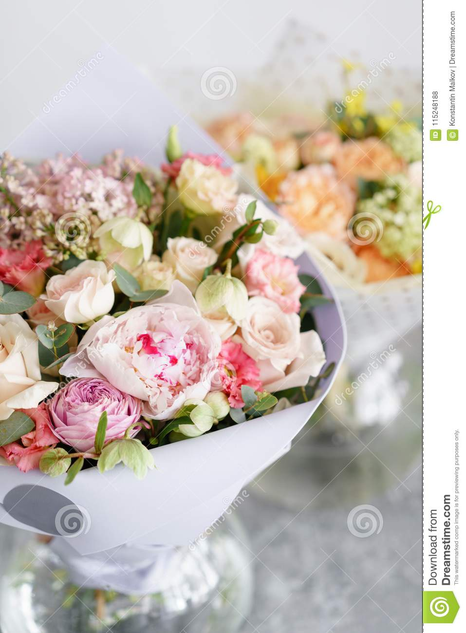 Two bouquet of beautiful flowers on gray table floristry concept download two bouquet of beautiful flowers on gray table floristry concept spring colors mightylinksfo