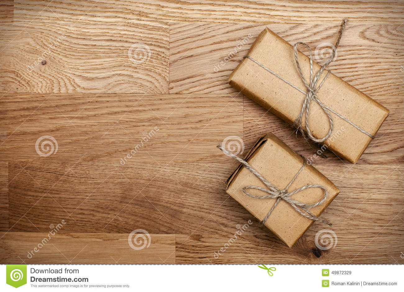 Two boxes in eco paper on the wooden table top view