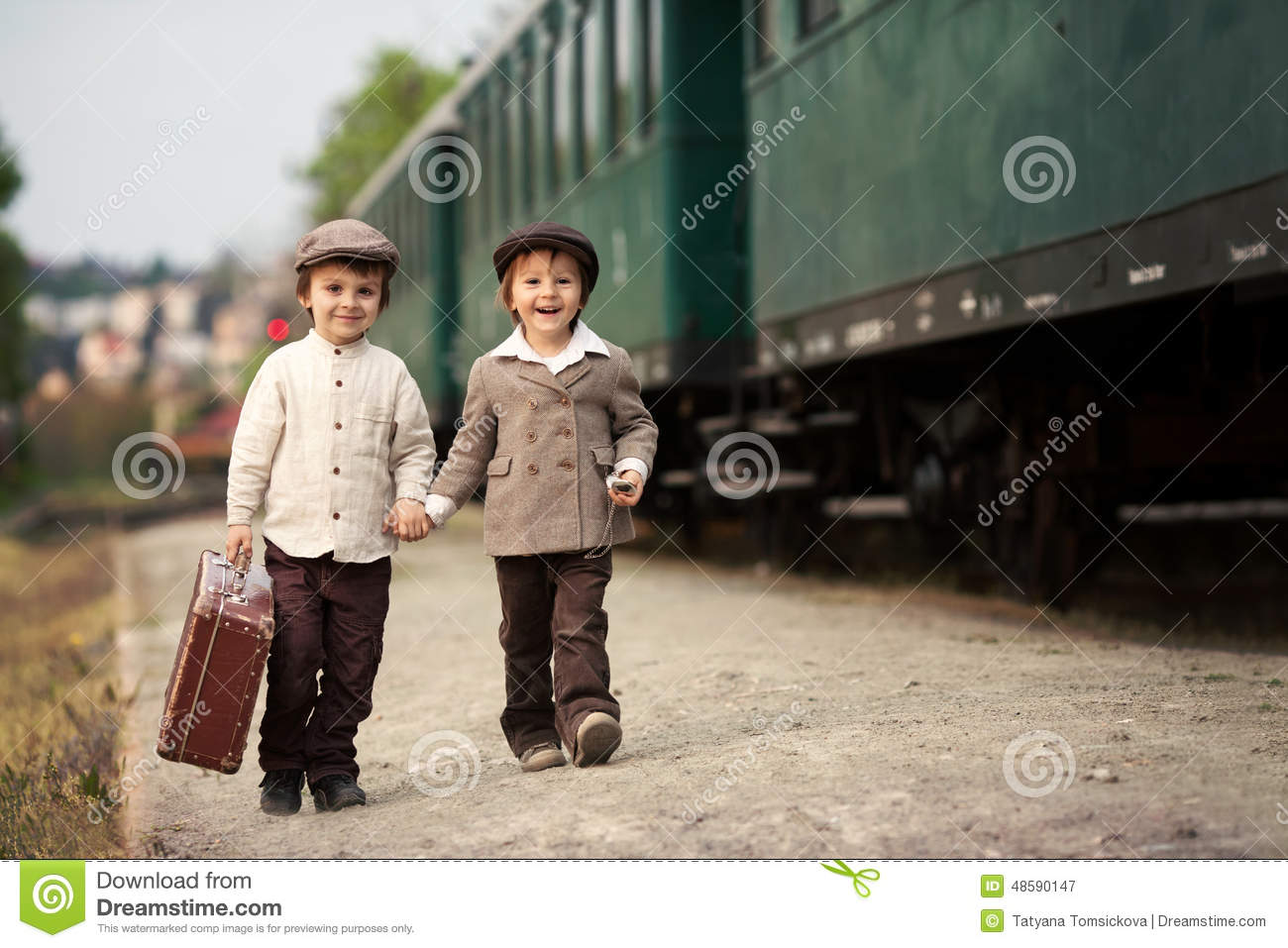 b63d0aa5efbdf Two Boys, Dressed In Vintage Clothing And Hat, With Suitcase Stock ...