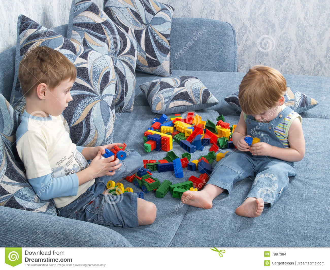 Play Toys For Boys : Two boys play toys stock photo image of background