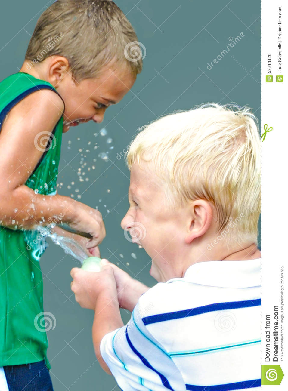 Two boys in a water balloon fight stock photo image 52214120