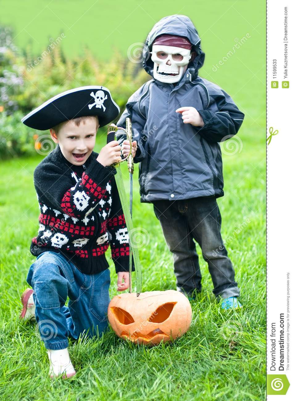 Two boys wearing halloween costumes