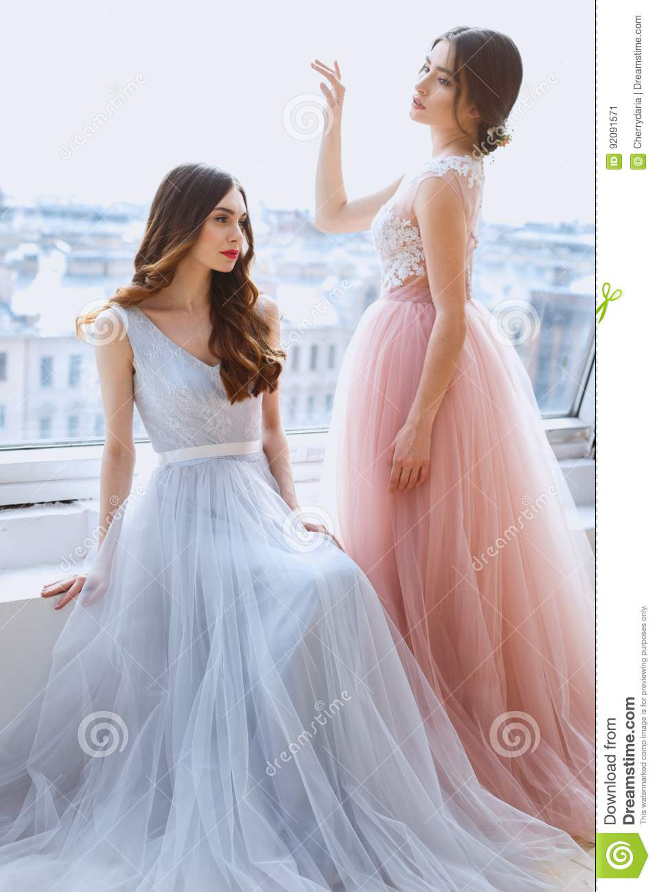 Two Brides In A Tender Light Pink And Blue Wedding Dresses In A